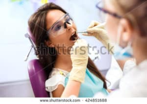 lady dental patient sitting in a dentist chair