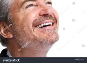 close up of a man smiling